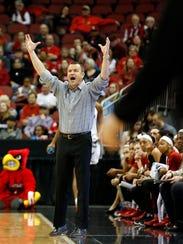 Louisville coach Jeff Walz reacts from the sideline.