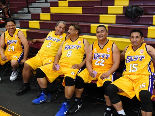 The Supermanamko East all-stars display bench camaraderie during the Filipino Sports Association of Guam hoops all-star game at the Father Duenas Phoenix Center in Mangilao on Jan. 10.