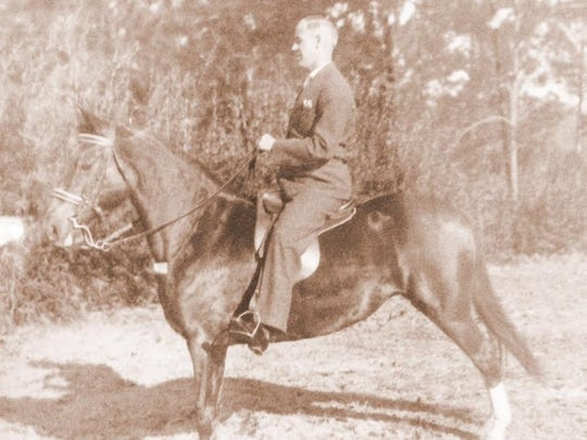 """Carole Baxter's grandfather, Roy O. Martin, is shown riding an American saddlebred horse, """"Lady,"""" in the 1930s near his home in Pineville."""