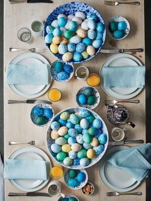 For striking centerpieces that celebrate the season, fill store‐bought spatterware and paint‐splattered disposable bowls with speckled eggs. Use hard‐cooked eggs and food‐safe dyes so guests can help themselves.