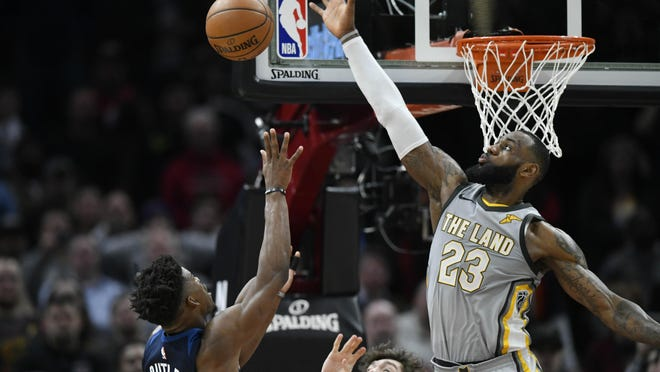 Feb 7, 2018; Cleveland, OH, USA; Cleveland Cavaliers forward LeBron James (23) blocks a shot by Minnesota Timberwolves guard Jimmy Butler (23) in overtime at Quicken Loans Arena. Mandatory Credit: David Richard-USA TODAY Sports