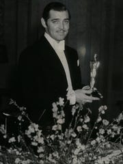 Clark Gable shows off his Academy Award for best actor