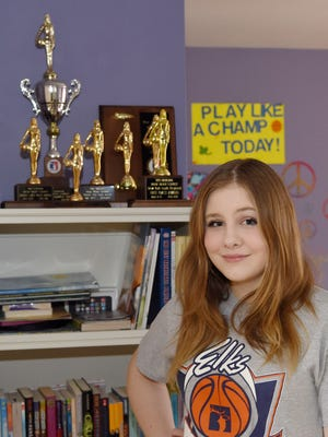 Juliana Kost  poses in front of her trophies at her home in the Town of Poughkeepsie on March 15, 2016.