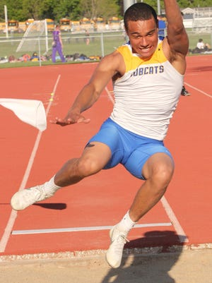 Lathan Cooper competes in the long jump for Benton at the WaMaC conference meet on Thursday, May 5.