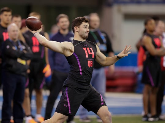Oklahoma quarterback Baker Mayfield throws during a drill at the NFL football scouting combine in Indianapolis, Saturday, March 3, 2018. (AP Photo/Michael Conroy)