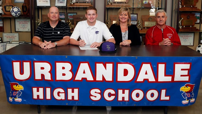 Urbandale High School student Ryan Lillard signed last fall to play baseball at Kansas State University. Ryan, second from left, is shown with his parents Mike and Tracie Lillard and, far right, Urbandale head baseball coach Denny Barton.