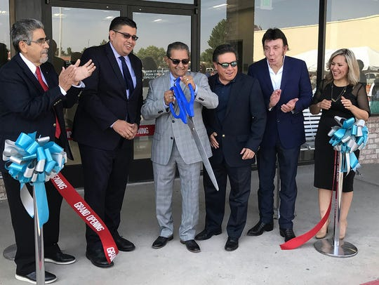 Centro San Vicente officials Aug. 3 celebrate the opening