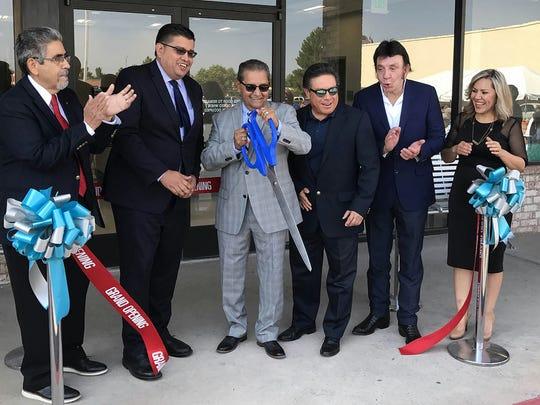 Centro San Vicente officials Aug. 3 celebrate the opening of its third clinic at 10780 Pebble Hills Blvd. in East El Paso. From left: Jose Luna, CEO; Rick Fernandez, secretary-treasurer; David Porras, board chairman; Presi Ortega Jr., vice chairman; Richard Castro, agency supporter; and Monica Miranda, board member.