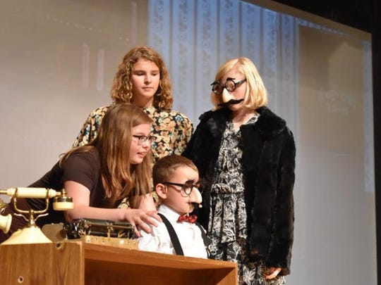 """Clockwise: Annika Yoder,  Ashlynn Hutchins, Nicole Wiley and Nash Scott rehearse a scene for the Penguin Project production of """"Annie Jr."""""""