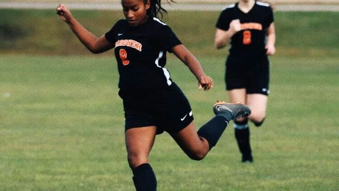 In addition to her three years spent on the Gardner High girls' soccer tean, Sam Sierra (foreground) played two years of field hockey and spent three seasons each on the Wildcats' indoor and outdoor track teams.