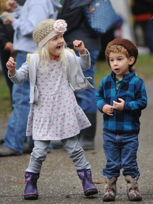 A pair of youngsters enjoyed the Tusky Valley Trojan marching band at the 2016 Atwood Fall Festival at Atwood Lake Park.