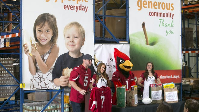 Arizona Cardinals quarterback Drew Stanton speaks during a donation event at St. Mary's Food Bank in Phoenix on Oct. 20, 2015. The Cardinals and Hyundai are sponsors of the donation event.