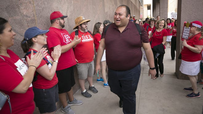 Rep. Daniel Hernandez, D-Tucson, walks through a crowd during last session's teacher walkout. He is one of nine Millennials in the House.