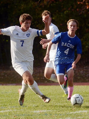 Lyman Memorial's Nick Barrett and Bacon Academy's Logan Miceli chase the ball during their game earlier this season in Colchester.