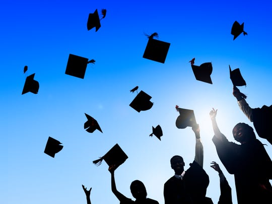 A national movement to reduce school suspensions could help students stay in school. Here, students celebrate graduation.
