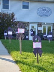 As part of Domestic Violence Awareness Month in October 2014, 39 wooden ribbons were placed in the VIP front yard to remember those who were lost in Wisconsin in 2013 to domestic violence, and 136 ribbons hang on a tree to commemorate victims who were served in Kewaunee County in 2013.