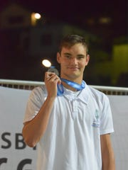 Guam's Ben Schulte shows off the silver medal he won at the 2015 Pacific Games in Port Moresby, Papua New Guinea, during the men's 100-meter breastroke finals. Schulte finished with a personal best of 1 minute and 3.42 seconds to finish second at the Tauram Aquatics center. Schulte had set the Pacific Games record in preliminaries at 1:04:62, but the top three finishers all broke the record in the finals.