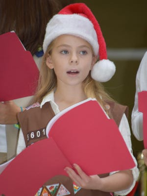 Emily Kukal, 8, of Millville sings Christmas carols at the Cumberland Mall with the Girl Scouts of Central and Southern New Jersey.