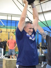 Egg Harbor Township Police Captain James Druding completes his final repetition during the Blue Lives Matter Community Strong CrossFit event at CrossFit OTG in Egg Harbor Township.