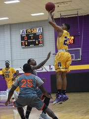 Former LSUA player Jordin Williams (23) scores three