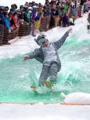 Spencer Heckert, dressed as a squirrel, competes in
