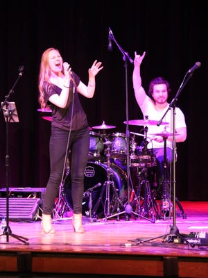 Matthiessen Nisch Quan, PCHS alumnus and professional drummer, returned with his own band, The Tubs, to rock Port Clinton High School last week. Emily Syring, the band's vocalist, is at left.