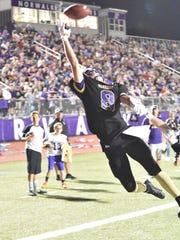 Norwalk's #8 Drew Rosonke stretches for a touchdown