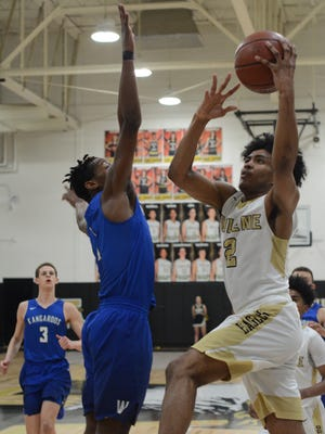 Abilene High's David Russell goes in for a layup on Weatherford's Deandre Curry during the Eagles' 82-73 win Friday at Eagle Gym.