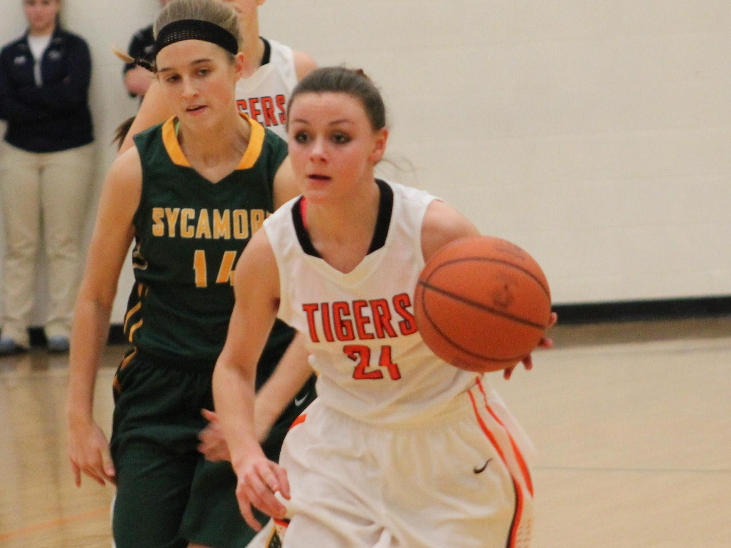 Sycamore's Kelsey Kandil chases Colleen Swift of Loveland last February.