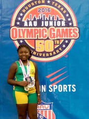 Ayanna Hunt, of Anderson, is at the podium where she accepted her gold medal in shot put, in Houston.