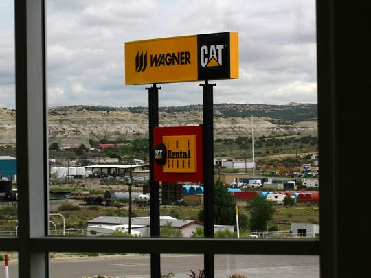 A sign for Wagner Equipment Co. is pictured on Aug. 24 overlooking the Animas Business Park in Bloomfield.