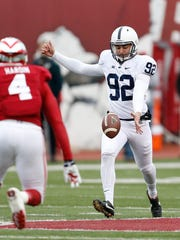 Penn State punter Daniel Pasquariello punts during the Nittany Lions' game against Indiana on Saturday in Bloomington, Indiana.