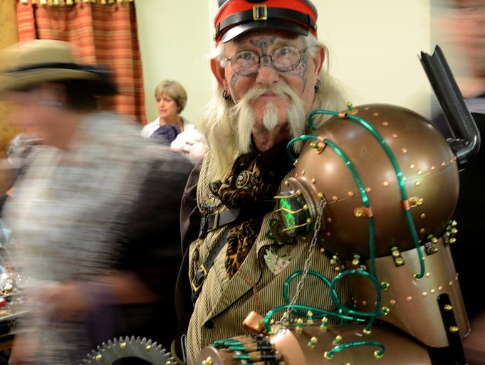"""Randy """"Carston Winslow"""" Hodges of Nevada City shows off his mechanical arm at the Biggest Little Steampunk Expo held July 19, 2014 at the Wilbur D. May Museum in Reno."""