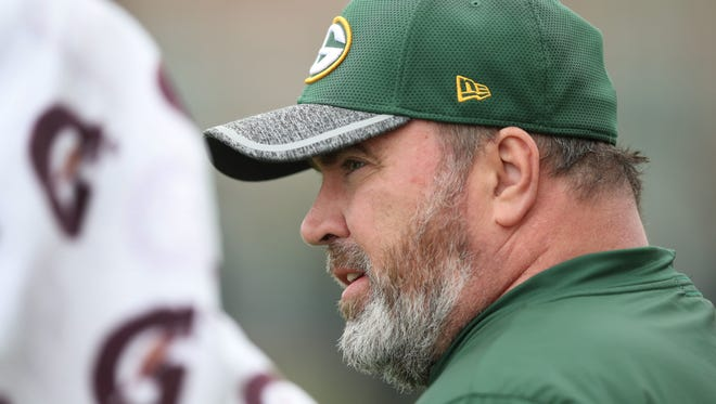 Green Bay Packers coach Mike McCarthy watches during organized team activities May 23, 2017 at Clarke Hinkle Field.