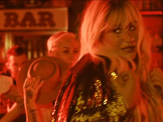 "Kesha as seen in her new music video for the song ""Woman,"" which was shot at Wilmington's Oddity Bar. The song will appear on her next album, ""Rainbow,"" due Aug. 11."