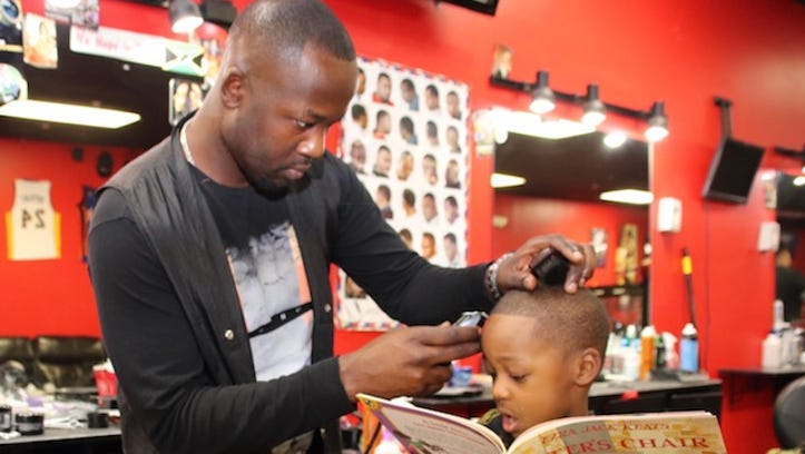 Plainfield's 'Books, Barbers and Dads' program inspires kids to read