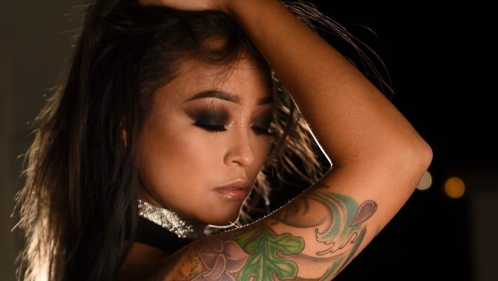 "Model Kristine ""Kai"" Young shows off her body art during"