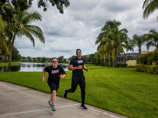 Personal trainer Sammy Callari works out with Parker Seward, 13, at his community gym in North Naples on Monday, Aug. 14, 2017. The pair have been working out together for a year and have developed a brother-like relationship. Callari works to spread awareness about the abilities, not disabilities, of those with Down syndrome.