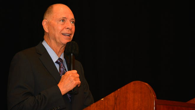 Community leaders, elected officials and pastors from various denominations gathered May 3 to offer up prayer for the nation and call for healing at the Space Coast Prayer Breakfast at the Rialto Hilton. Here, Rep. Bill Posey addresses the group.