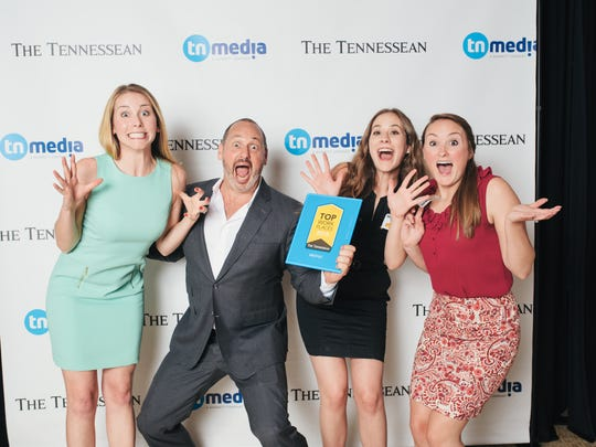 Kelly May, Jerry Bostelman, Bailey Newlan and Liz Marchetti Schimmer of Vaco celebrate the company's Top Workplace award in 2015.