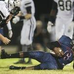 Mariner High School's Dalton Beyer, left, sacks Estero quarterback Willie Neal on Friday at Estero High School.