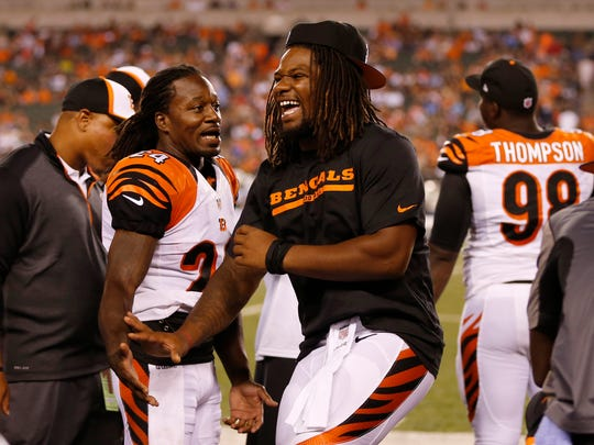 Bengals cornerback Adam Jones (left) and Burfict have a good time on the sideline during a 2014 game against the New York Jets at Paul Brown Stadium.