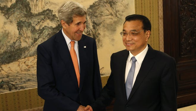 Secretary of State John Kerry shakes hands with Chinese Premier Li Keqiang during a meeting at Zhongnanhai Leadership Compound in Beijing on Saturday.