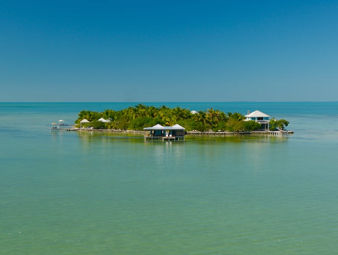 For those looking for something secluded, Belize's 4-acre islet Cayo Espanto rents seven private villas.