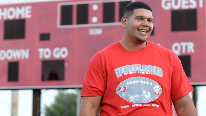 Vineland native Jamil Demby, shown here during a football camp with the Vineland Midget Football League in July, re-signed with the Los Angeles Rams on Wednesday.