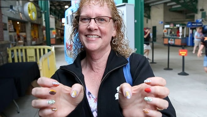Irene Cheney with her nails painted at garbage plates for Red Wings Plate Night. The left is the burger plate and right the hot dog plate.