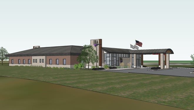 An architectural rendering depicts a proposed IHA medical building that would be built at 202 W. Highland Road/M-59 in the Crossroads Town Center in Howell.