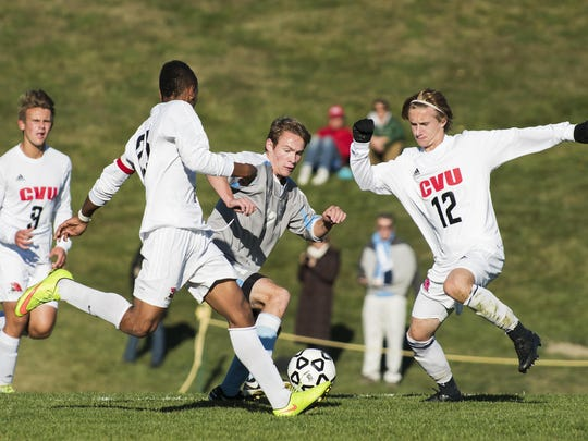 South Burlington's Patrick O'Hara (17) battles for the ball with CVU's Trey Tomasi (25) and Joe Parento (12) during the high school boys soccer game between the South Burlington Rebels and the Champlain Valley Union Redhawks on Monday afternoon in Hinesburg.