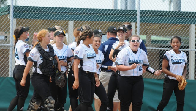 District 3 Big League Softball team celebrates after beating Southeast, the No. 1 seed, 2-1 on Friday, in Roxana, Del.