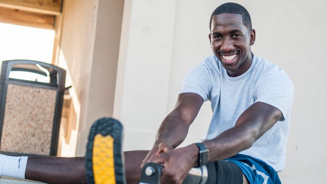 Senior Airman Kevin Greene, a health care management technician with the 920th Aeromedical Staging Squadron, stretches after a short workout Aug. 8, 2017 at Patrick Air Force Base, Fla. Greene lost a portion of his left leg in a motorcycle accident on Dec. 17, 2014.